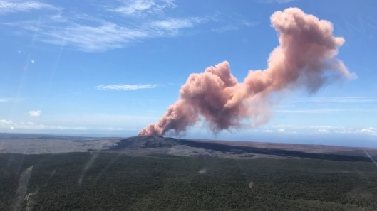 A plume of ash rises from Kilauea Volcano, one of five on the island, after a series of earthquakes over the last couple of days, in Hawaii